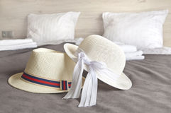 Man and woman hats on a hotel bed - holiday time Stock Image