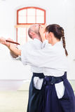 Man and woman having Aikido knife fight Royalty Free Stock Photography