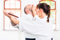 Man and woman having Aikido knife fight Stock Photos