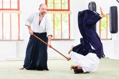 Man and woman having Aikido stick fight royalty free stock photo