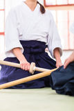 Man and woman having Aikido sword fight Stock Photography
