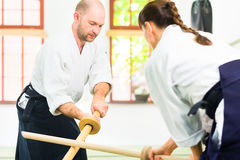Man and woman having Aikido sword fight Stock Photo
