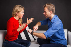 Man and woman having an argument about being late Stock Photos
