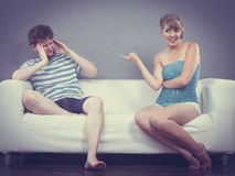 Man and woman having argument sitting on sofa at home Royalty Free Stock Photos