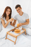Man and woman having breakfast in bed Royalty Free Stock Images