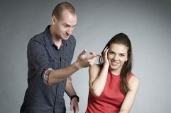 Man and woman having conflict Stock Photos