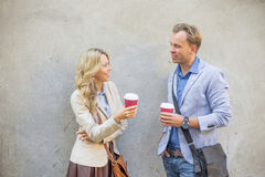 Man and woman having a conversation Stock Images