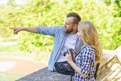 Man and woman having date outdoor. Girl wit a photo camera and her boyfriend. stock photography