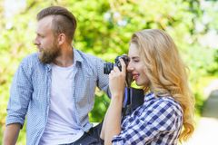 Man and woman having date outdoor. Girl wit a photo camera and her boyfriend. stock images