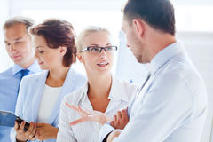 Man and woman having discussion in office Stock Photography