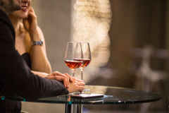 Man and a woman having drinks/glass of wine at a bar Royalty Free Stock Image