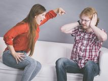 Man and woman having fight. Man and women having conflict. Female ignoring what her boyfriend is saying. Friendship, couple breakup difficulties and problems royalty free stock photography