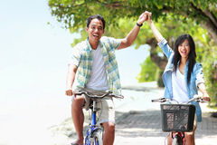 Man and woman having fun riding bicycle together Royalty Free Stock Images