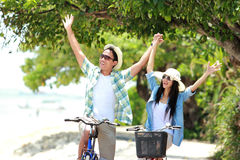 Man and woman having fun riding bicycle together Royalty Free Stock Photo