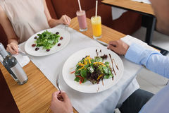 Man and woman having lunch at cafe stock photography