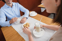 Man and woman having lunch at cafe Stock Image