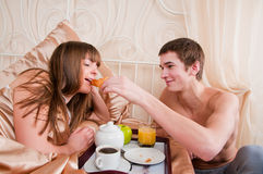 Man and woman having luxury hotel breakfast Royalty Free Stock Photos