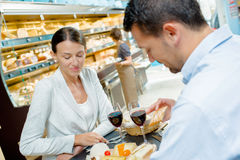 Man and woman having meal in canteen Royalty Free Stock Image