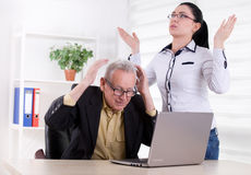 Man and woman having problem in their work Stock Images