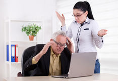 Man and woman having problem in their work Royalty Free Stock Images