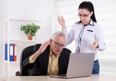 Man and woman having problem in their work Stock Photo