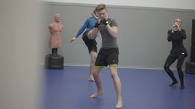 Man and woman having training in the gym. Warming up before sparring. Male and female legs turning on the toes. Man and woman having training in the gym stock footage