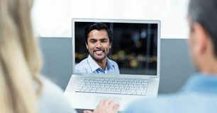 Man and woman having video call on laptop stock photos