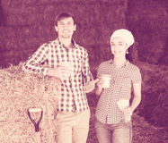 Man and woman in hay with milk Royalty Free Stock Photography