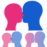 Man and woman head silhouette kissing Royalty Free Stock Images