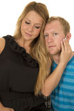 Man and woman heads together close her hand on his face Royalty Free Stock Images