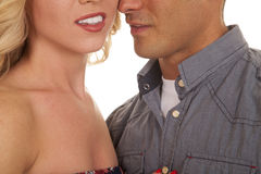 Man and woman heads very close from nose down Stock Photos