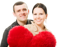Man and woman with a heart in his hands Stock Images