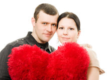 Man and woman with a heart in his hands Stock Photography