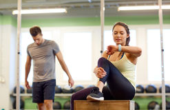 Man and woman with heart rate tracker in gym Royalty Free Stock Photo