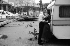 Man and woman is hidden from view behind a trailer Royalty Free Stock Photography