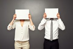 Man and woman hiding their faces Royalty Free Stock Photography