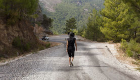Man and woman hikers trekking roads in Turkey Royalty Free Stock Photo