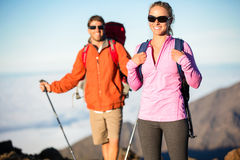 Man and woman hiking on beautiful mountain trail Royalty Free Stock Photos
