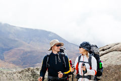 Man and woman hiking in mountains Stock Images