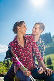 Man and woman hiking the mountains Royalty Free Stock Photos