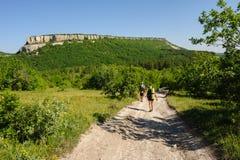 Man and woman hiking Stock Photos