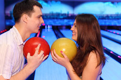 Man and woman hold balls in bowling Royalty Free Stock Images
