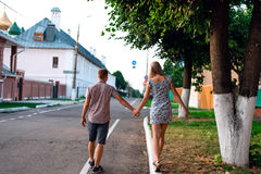 Man and woman hold each other`s hand, summer in city, concept of event young family, newlyweds complex relationship Royalty Free Stock Photos