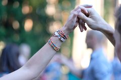 A dance at the festival. Man and woman hold hands, performing a dance at the festival Royalty Free Stock Photography