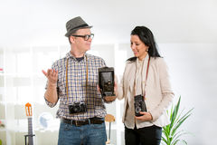 Man and woman hold retro camera Stock Photos