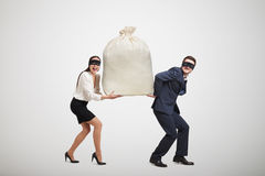 Man and woman holding big bag Royalty Free Stock Photo