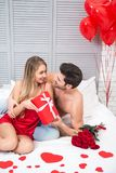 Man and woman holding big red gift box stock photo