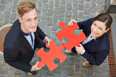 Man and woman holding big red Royalty Free Stock Photo