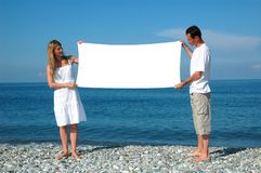 Man and woman holding billboard royalty free stock photography