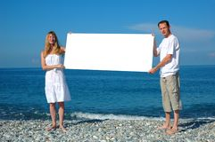 Man and woman holding blank billboard Stock Images